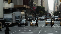 Slow motion panning wide shot of bustling city street / New York City, New York, Stock Footage
