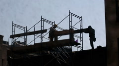 Construction Workers Silhouette Hardhats Scaffolding Building NYC Union Stock Footage