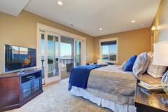 master bedroom with walkout deck - stock photo