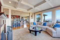 luxury house with open floor plan. coffered ceiling, carpet and hardwood floo - stock photo