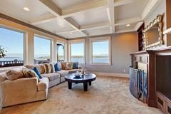 warm living room interior in luxury house with puget sound view - stock photo