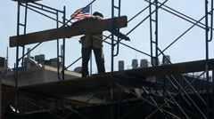 Construction Worker Silhouette American Flag Scaffolding Building NYC Union Stock Footage