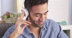 Handsome Mexican guy listening to music Stock Footage