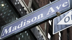 Low angle close up of Madison Avenue street sign / New York City, New York, Stock Footage