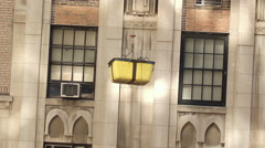 Yellow Bucket Lowered Down to Construction Workers on Scaffolding Job Site NYC Stock Footage