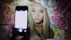 Close up low angle shot of teenage girl taking self-portrait with camera phone Stock Footage