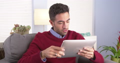 Puerto Rican guy talking to someone on his tablet Stock Footage