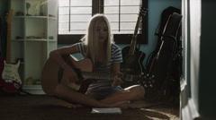 Medium shot of teenage girl playing guitar / Sandy, Utah, United States Stock Footage