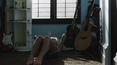 Medium shot of teenage girl doing sit-ups in bedroom / Sandy, Utah, United Stock Footage