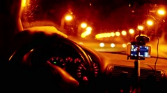 Blur view of car driving at night with illuminated dashboard and navigation, Stock Footage
