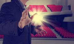 success businessman as theater manager - stock illustration