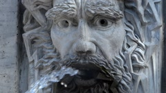 Ancient Fountain - Water Jet from Bas-relief Sculpture Stock Footage