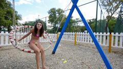 Young beautiful joy girl is having fun on a beach swing Stock Footage