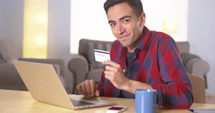 Hispanic man smiling with credit card Stock Footage