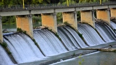 spring flood water flowing on hydroelectric power station dam - stock footage