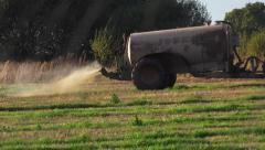 Agriculture Farming Tractor Spreading Fertilizer On Field Stock Footage