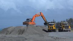 Time lapse of excavator loading trucks in 4k Stock Footage