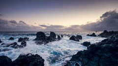 Sunset with waves hitting the rocks, Magic Lantern RAW video Stock Footage