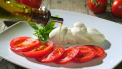 Pouring olive oil over caprese salad Stock Footage