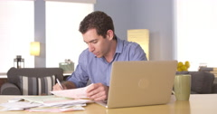 Stock Video Footage of Young man doing his taxes