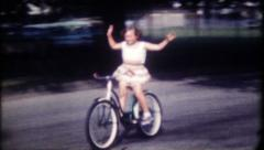 1205 - neighborhood bicycle ride - vintage film home movie - stock footage