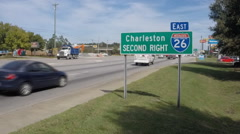 A road sign directs drivers to Charleston, SC (3 of 3) Stock Footage