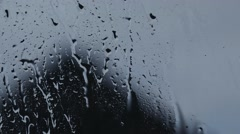 Raindrops running down a window ambient background Stock Footage