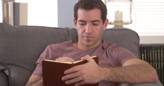 Man writing down thoughts in journal - stock footage