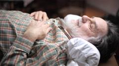 Elderly man asleep - stock footage