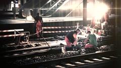 Railroad workers make repairs rails - stock footage