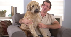 Man sitting with his dog Stock Footage