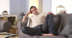 Tired man resting on couch at home - stock footage
