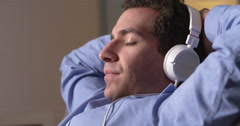Businessman taking a break and listening to music Stock Footage