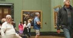 OAP resting in art gallery 4K Stock Footage