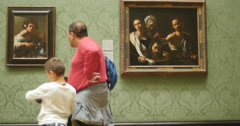 Father and son quality time together at art gallery 4K Stock Footage