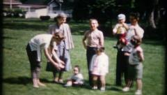 1215 - family gathers for a portrait in the backyard - vintage film home movie Stock Footage