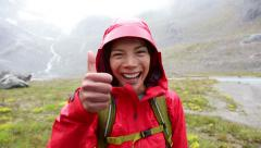 Thumbs up hiking woman happy looking at camera Stock Footage