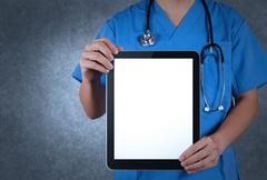 doctor working with tablet computer - stock illustration