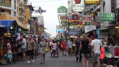 Tourists Walking Down Busy Khao San Road in Bangkok, Thailand Stock Footage