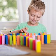 Little boy playing with colored Stock Photos