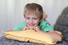 cute attractive little boy with a toothy grin - stock photo