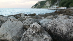 Sea wave impinges on an old stony - stock footage