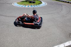 having fun on a go cart - stock photo