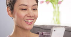 Chinese woman using webcam on smartphone Stock Footage