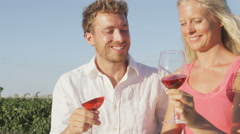 Wine drinking couple happy at vineyard smelling and tasting wine Arkistovideo