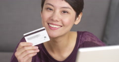 Attractive Asian woman holding credit card Stock Footage