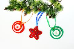 christmas ornament background of handmade toys fleece and felt - stock photo