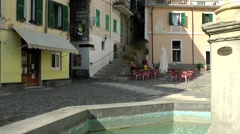 Europe Italy Liguria Airole village 016 basin of water well on deserted piazza Stock Footage