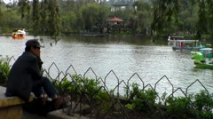Alone in the lake side of Burnham Park Baguio City Philippines Stock Footage