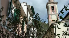 Europe Italy Liguria Airole village 018 pastel colored church tower Stock Footage